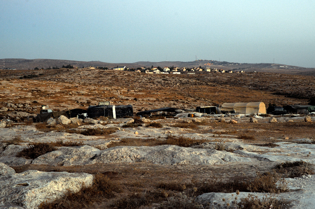 The Palestinian village of Susiya overlooking the Jewish settlement by the same name