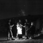 The Awad family gathers at the bonfire at dwan.